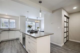 Photo 9: 18 23 GLAMIS Drive SW in Calgary: Glamorgan Row/Townhouse for sale : MLS®# C4293162