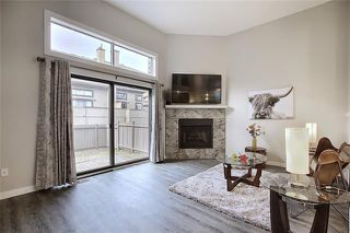 Photo 1: 18 23 GLAMIS Drive SW in Calgary: Glamorgan Row/Townhouse for sale : MLS®# C4293162