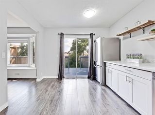 Photo 3: 235 ABOYNE Place NE in Calgary: Abbeydale Semi Detached for sale : MLS®# A1015805