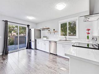 Photo 2: 235 ABOYNE Place NE in Calgary: Abbeydale Semi Detached for sale : MLS®# A1015805