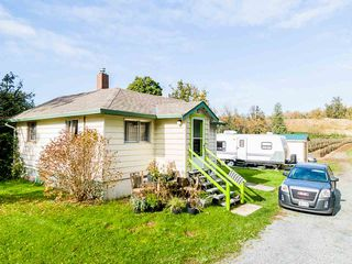 Photo 1: 34141 FARMER Road in Abbotsford: Poplar House for sale : MLS®# R2511876