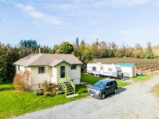 Photo 2: 34141 FARMER Road in Abbotsford: Poplar House for sale : MLS®# R2511876