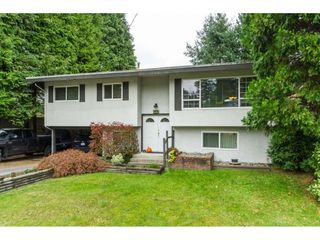 Photo 1: 6782 130 Street in Surrey: West Newton House for sale : MLS®# R2509281
