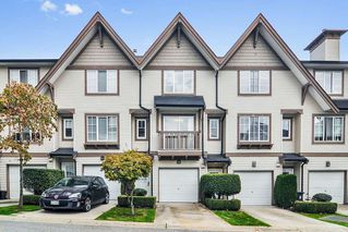 """Photo 1: 51 20540 66 Avenue in Langley: Willoughby Heights Townhouse for sale in """"Amberleigh"""" : MLS®# R2409971"""