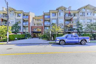 "Photo 1: 216 100 CAPILANO Road in Port Moody: Port Moody Centre Condo for sale in ""SUTERBROOK"" : MLS®# R2496412"