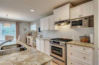 Photo 8: 548 Auburn Bay Heights SE in Calgary: Auburn Bay Detached for sale : MLS®# A1041418