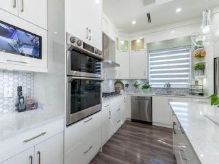 "Photo 12: 14050 91A Avenue in Surrey: Bear Creek Green Timbers House for sale in ""Bear Creek Green Timber"" : MLS®# R2511466"