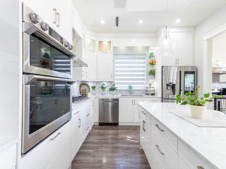 "Photo 19: 14050 91A Avenue in Surrey: Bear Creek Green Timbers House for sale in ""Bear Creek Green Timber"" : MLS®# R2511466"
