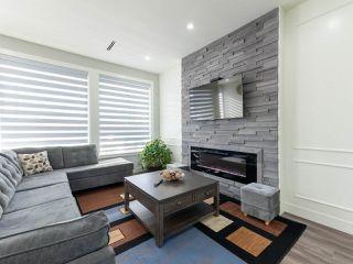 "Photo 14: 14050 91A Avenue in Surrey: Bear Creek Green Timbers House for sale in ""Bear Creek Green Timber"" : MLS®# R2511466"