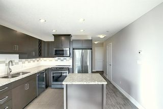 Photo 3: 402 77 Spruce Place SW in Calgary: Spruce Cliff Apartment for sale : MLS®# A1046854