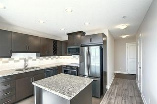 Photo 4: 402 77 Spruce Place SW in Calgary: Spruce Cliff Apartment for sale : MLS®# A1046854