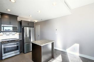 Photo 5: 402 77 Spruce Place SW in Calgary: Spruce Cliff Apartment for sale : MLS®# A1046854