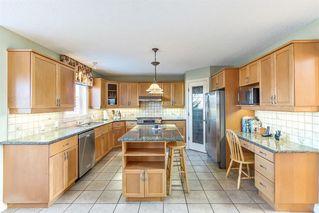 Photo 5: 217 Hamptons Gardens NW in Calgary: Hamptons Detached for sale : MLS®# A1055777