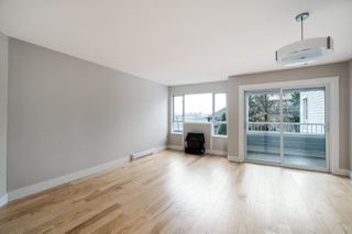 """Photo 3: 201 1330 GRAVELEY Street in Vancouver: Grandview Woodland Condo for sale in """"Hampton Court"""" (Vancouver East)  : MLS®# R2466394"""