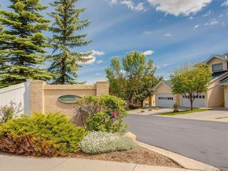 Photo 1: 42 200 SANDSTONE Drive NW in Calgary: Sandstone Valley Row/Townhouse for sale : MLS®# A1027808