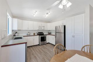 Photo 14: 42 200 SANDSTONE Drive NW in Calgary: Sandstone Valley Row/Townhouse for sale : MLS®# A1027808