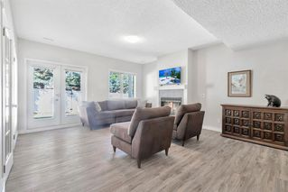 Photo 9: 42 200 SANDSTONE Drive NW in Calgary: Sandstone Valley Row/Townhouse for sale : MLS®# A1027808