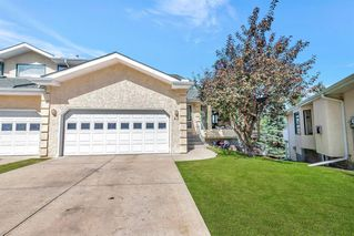 Photo 2: 42 200 SANDSTONE Drive NW in Calgary: Sandstone Valley Row/Townhouse for sale : MLS®# A1027808