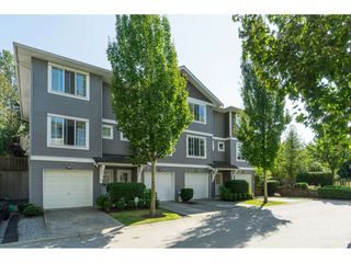 "Photo 1: 73 15155 62A Avenue in Surrey: Sullivan Station Townhouse for sale in ""Oaklands"" : MLS®# R2394046"