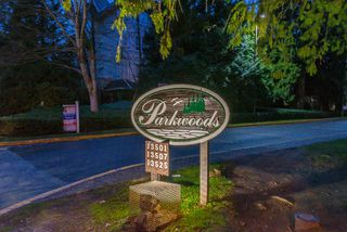 "Photo 1: 113 13507 96TH Avenue in Surrey: Queen Mary Park Surrey Condo for sale in ""Parkwoods-Balsam Building"" : MLS®# R2439606"