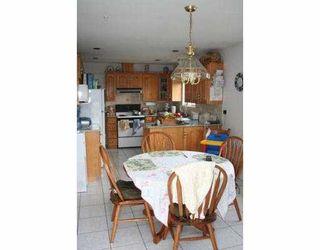 Photo 3: 2047 E 4TH AV in Vancouver: Grandview VE House for sale (Vancouver East)  : MLS®# V583192