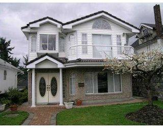 Photo 1: 2047 E 4TH AV in Vancouver: Grandview VE House for sale (Vancouver East)  : MLS®# V583192
