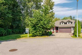 "Photo 2: 6922 182 Street in Surrey: Cloverdale BC House for sale in ""Cloverwoods"" (Cloverdale)  : MLS®# R2482440"