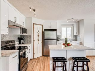 Photo 7: 50 Arbour Crest Way NW in Calgary: Arbour Lake Detached for sale : MLS®# A1039897