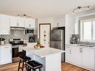 Photo 5: 50 Arbour Crest Way NW in Calgary: Arbour Lake Detached for sale : MLS®# A1039897