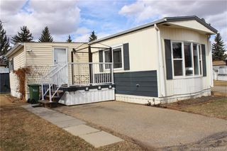 Main Photo: 59 Parkside Drive in Red Deer: RR Normandeau Residential Mobile for sale : MLS®# CA0192758