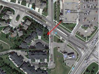 Photo 11: 6 STRATHRIDGE Lane SW in Calgary: Strathcona Park Land for sale : MLS®# A1029671