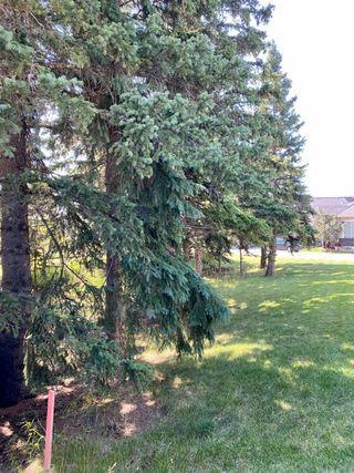 Photo 7: 6 STRATHRIDGE Lane SW in Calgary: Strathcona Park Land for sale : MLS®# A1029671