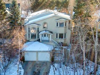 Main Photo: 619 Crescent Boulevard SW in Calgary: Elboya Detached for sale : MLS®# A1061776