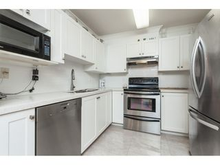 """Photo 9: 103 6385 121 Street in Surrey: Panorama Ridge Condo for sale in """"BOUNDARY PARK PLACE"""" : MLS®# R2391175"""