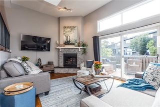 Photo 3: 124 GLAMIS Terrace SW in Calgary: Glamorgan Row/Townhouse for sale : MLS®# C4267866