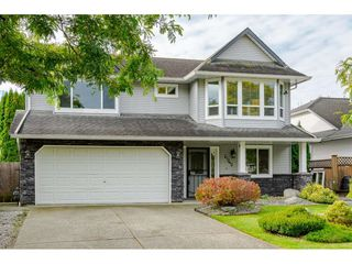 Photo 1: 27242 32B Avenue in Langley: Aldergrove Langley House for sale : MLS®# R2409871