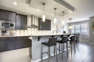 Photo 6: 158 AUBURN GLEN Circle SE in Calgary: Auburn Bay Detached for sale : MLS®# A1029957