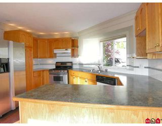 Photo 2: 35619 DINA Place in Abbotsford: Abbotsford East House for sale : MLS®# F2728107
