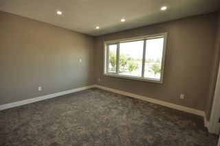 Photo 12: 8753 92A Avenue in Edmonton: Zone 18 House for sale : MLS®# E4203954