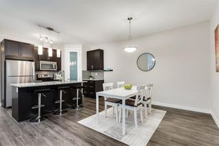 Photo 11: 1704 2461 BAYSPRINGS Link SW: Airdrie Row/Townhouse for sale : MLS®# A1010351