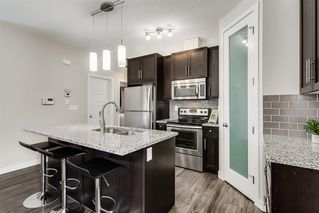 Photo 7: 1704 2461 BAYSPRINGS Link SW: Airdrie Row/Townhouse for sale : MLS®# A1010351