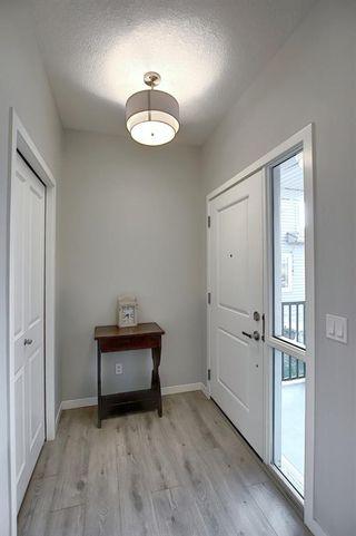 Photo 2: 44 Emberside Place: Cochrane Semi Detached for sale : MLS®# A1036728