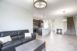 Photo 10: 44 Emberside Place: Cochrane Semi Detached for sale : MLS®# A1036728