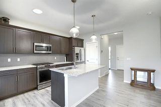 Photo 4: 44 Emberside Place: Cochrane Semi Detached for sale : MLS®# A1036728
