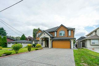 Photo 1: 12848 93 Avenue in Surrey: Queen Mary Park Surrey House for sale : MLS®# R2397085