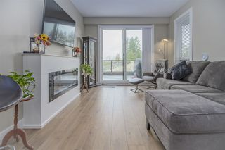 """Photo 3: 404 12460 191 Street in Pitt Meadows: Mid Meadows Condo for sale in """"Orion"""" : MLS®# R2457439"""