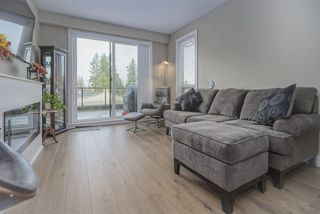 """Photo 2: 404 12460 191 Street in Pitt Meadows: Mid Meadows Condo for sale in """"Orion"""" : MLS®# R2457439"""