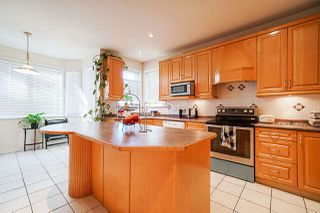 Photo 12: 6055 125A Street in Surrey: Panorama Ridge House for sale : MLS®# R2503823