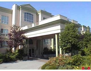 "Photo 1: 13860 70TH Ave in Surrey: East Newton Condo for sale in ""Chelsea Gardens"" : MLS®# F2625815"