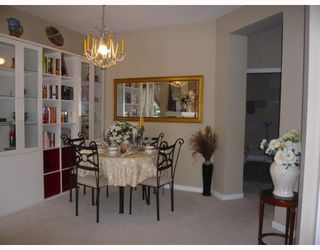 """Photo 1: # 108 2969 WHISPER WY in Coquitlam: Westwood Plateau Condo for sale in """"SILVER SPRING"""" : MLS®# V786491"""